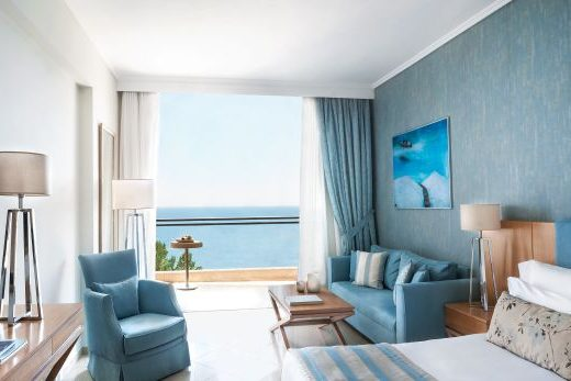 hotel room in blue with ocean view at the ikos oceania resort