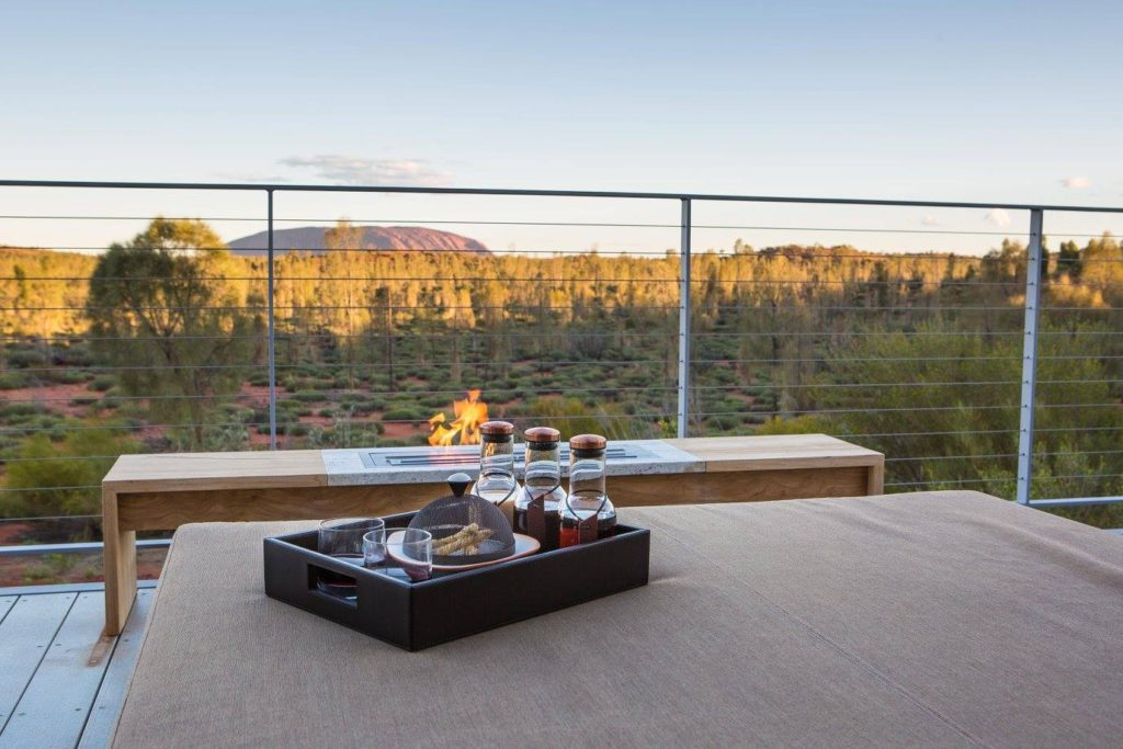 A tray of goods on a balcony overlooking Australia landscape