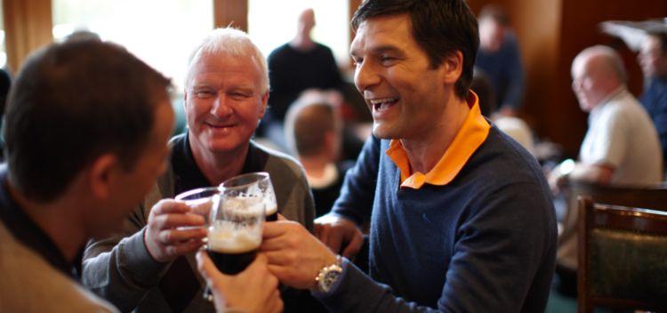 three men toasting at the dukes clubhosue