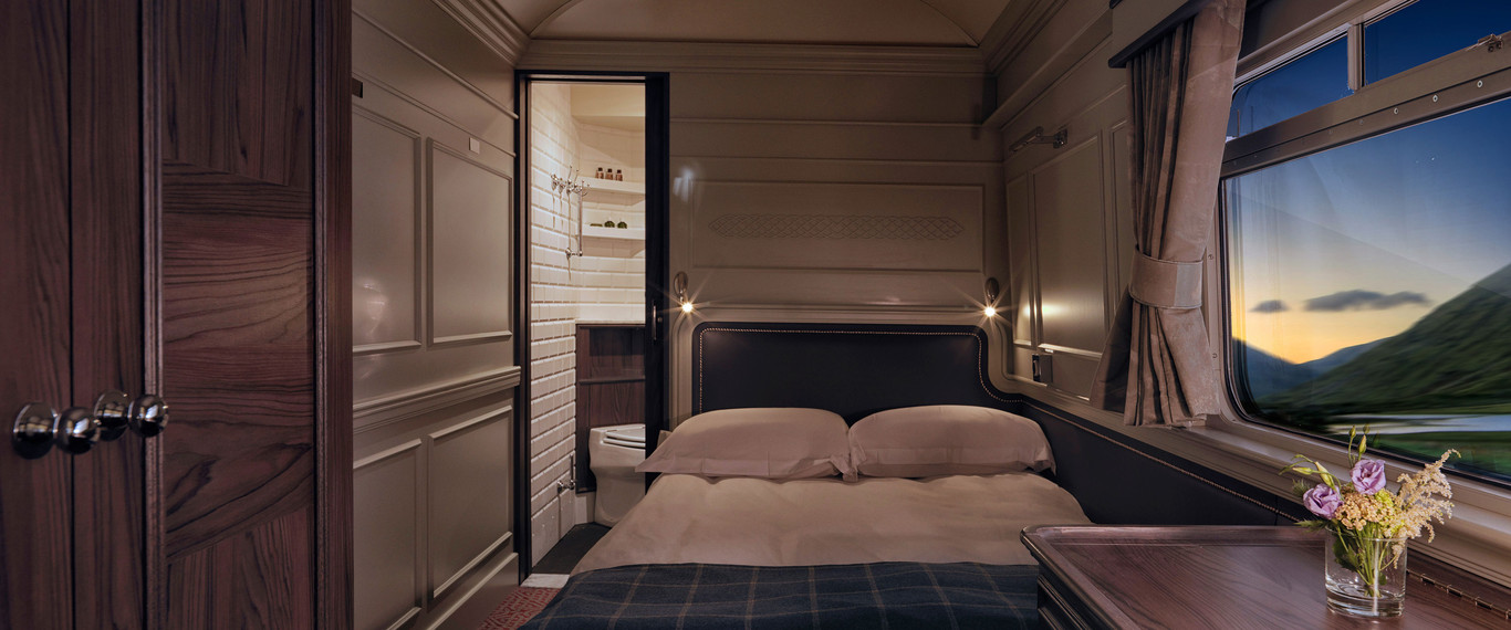 double bed in the Belmond Grand Hibernian train