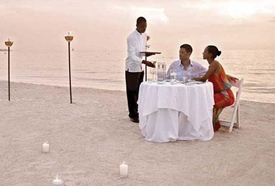 a couple dining on the beach of Jamaica