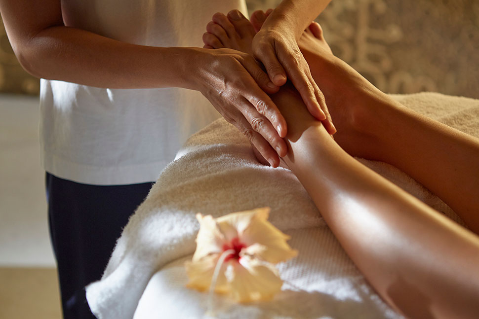 Man massaging feet at the spa in Iniala Beach House