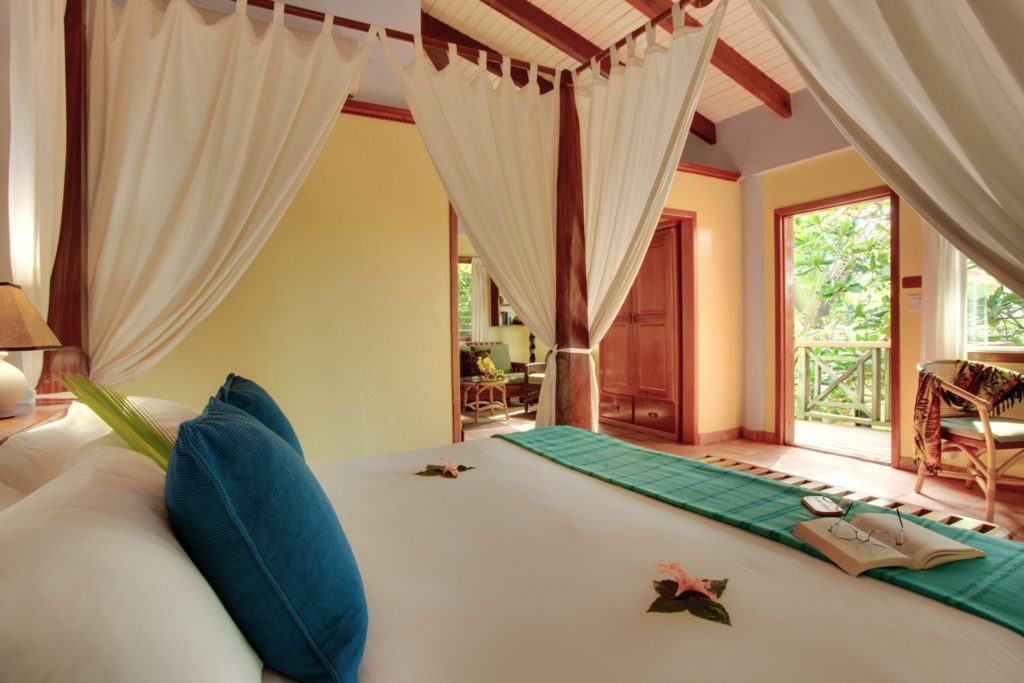 king bed in a Hamanasi Adventure & Dive Resort hotel room