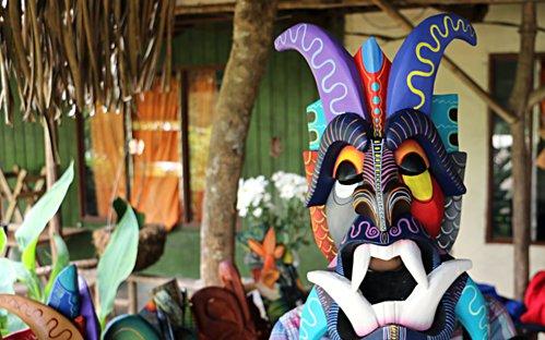 Person wearing a boruca mask