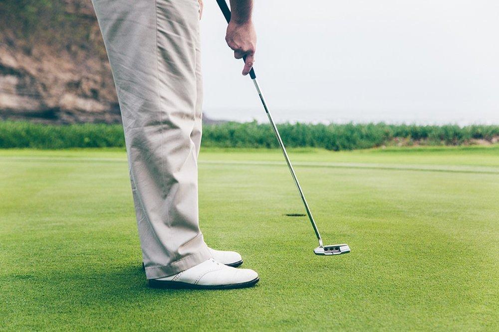 view of man golfing at Mukul Resort