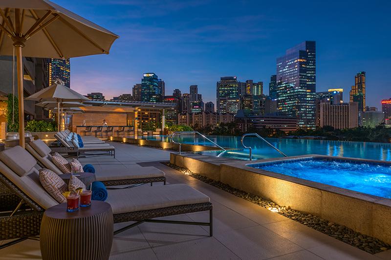Hotel pool and Makati Skyline