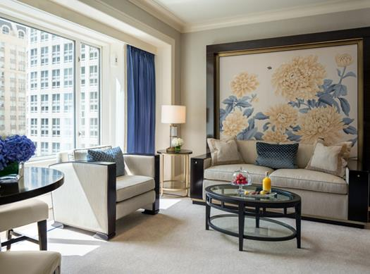 Couches in the Peninsula Chicago Suite with a blue floral painting