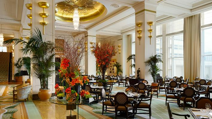 The Peninsula Chicago restaurant, The Lobby, with gold ceilings and fresh flowers