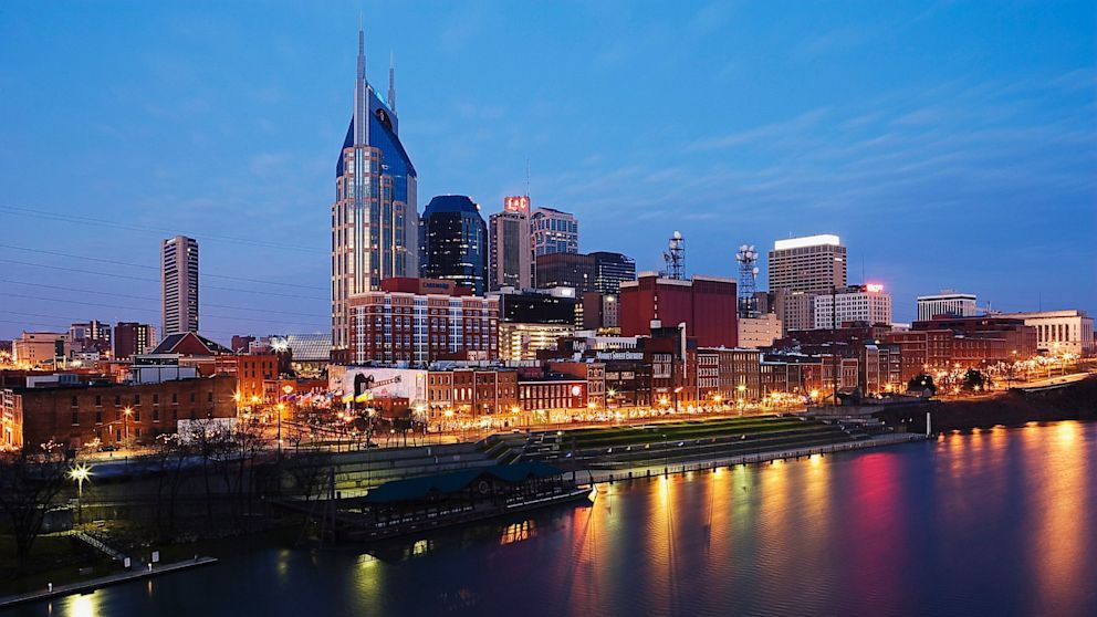 A view of the Nashville cityscape with a river in front