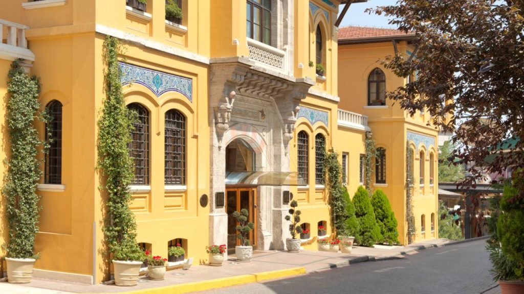 Street view of yellow walls at the front of Four Seasons Hotel Istanbul at Sultanahmet.