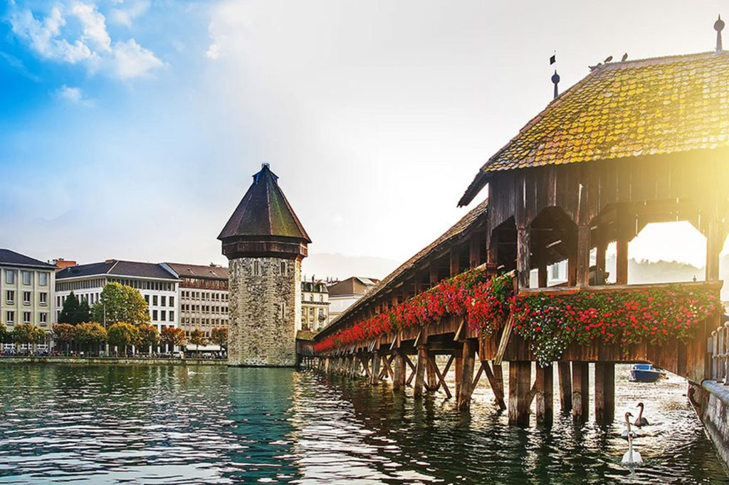 view of Lake Lucerne and a wooden bridge and steeple