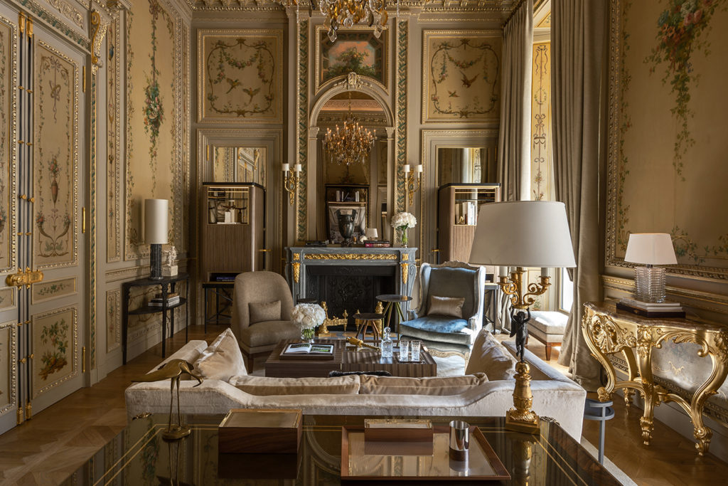 Suite Duc de Crillon sitting room with Neoclassical fireplace and arabesques on the walls