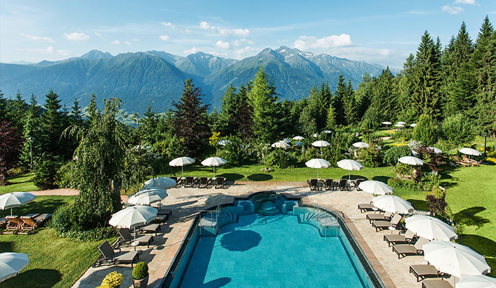 pool at hotel with view of the mountains in the background